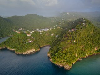 The Treehouse Studio on the point on the right with the secluded beach and Marigot Bay to the left