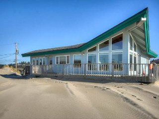 Oceanfront home right on the beach with wrap around deck!