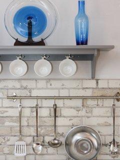 Frontal de la cocina, decorada en tonos azules.