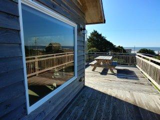 Cape Hideaway modern beach house with nice ocean views , short walk to the beach