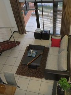 Light and airy own use living/lounge area leading onto own use balcony with barbeque area.