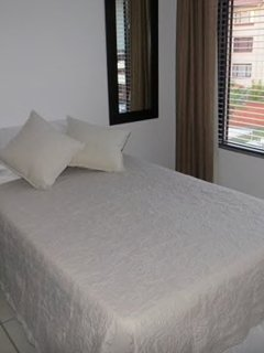 Guest room 2 with twin bed and private bathroom.