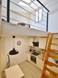 Mansard apartment, with mezzanine sitting area.