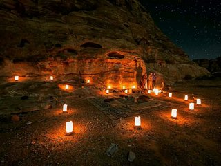 sitting place with candles and fire under the sky.
