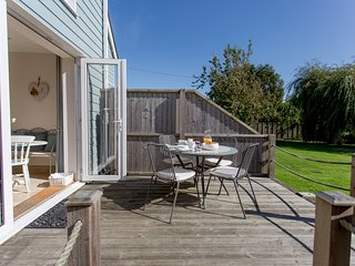 Main entrance to Waterfront Retreat. Private decking overlooking the mature garden.