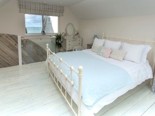 Master bedroom. Double aspect windows with sea views to the North and countryside to the South.