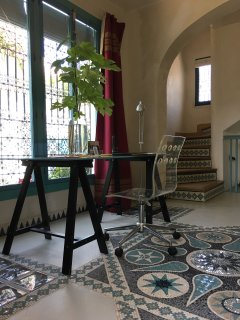 The Entrance hall, with mosaic floor and stairs.