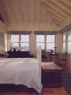 3rd floor master bedroom with wrap-around views of ocean, marina and marsh