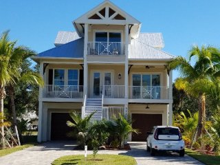 Key West Style with Water Views at Seabreeze with ample parking.