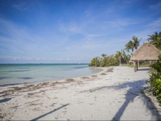 **Summer Promo** Sandy Beach & Boat Dock at this Tropical Beachfront Townhouse