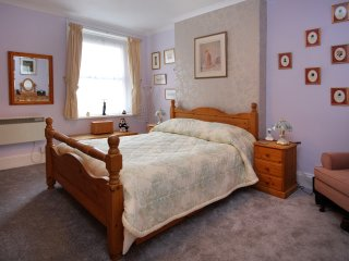 Ground floor one bedroomed flat in a Large Victorian Town House with own parking