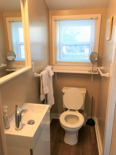 Updated main floor three piece bath with new floors, vanity, and other upgrades!