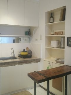Complete kitchen with induction cooker, microwave oven, toaster, kettle and refrigerator