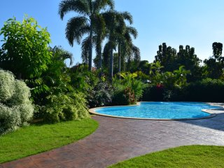 Large landscaped tropical gardens and secluded private swimming pool