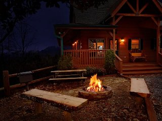 Enjoy mountains views, hot tub, firepit and a private theater experience!