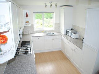 Modern Kitchen with double oven, microwave, dishwasher and large Fridge Freezer.