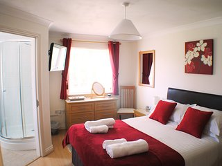 Main Bedroom showing door to ensuite and large chest of draws.