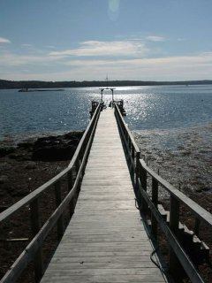 Private dock accessible to both cottages with stairs down to the rocky beach