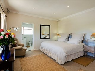 Main bedroom Super King bed full bathroom on Suite North View Backdrop Table Mountain Summer/Winter