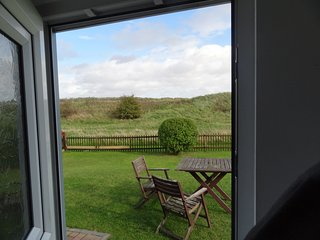 Our view from the front door! The garden and sand dunes - you can hear the sea when the tide is in!