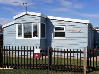 Stunning 3 bedroom Beach Chalet as close as you can get to the beach!