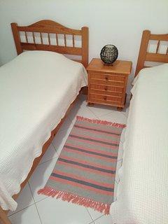 Quarto com duas camas solteiras