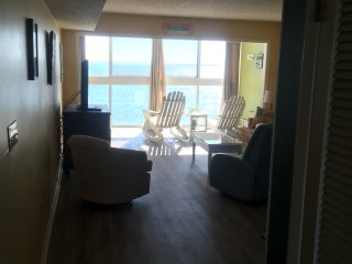 Oceanfront condo steps from the beach, breathtaking sunrises & sunsets!