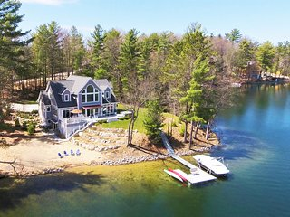 Exceptional waterfront retreat with sandy beach on all sports Spider Lake