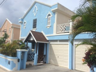 Seagrass exterior freshly painted in bright tropical blue