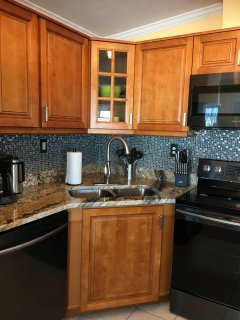 Updated kitchen with modern high-end faucet and sink