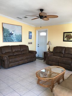 Living room with ceiling fan, reclining sofa and loveseat