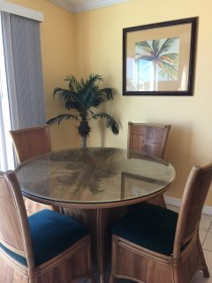 Dining room with lovely rattan table and chairs