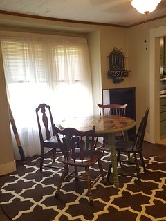 Dining area with room for five at the table.
