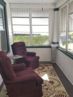 Front porch with two comfy recliners for watching passersby or just enjoying the Ithaca neighborhood