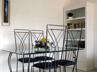 hand crafted dining furniture (6 chairs )Book shelves with games and tourist info.