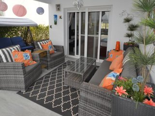 relax with family on ultra comfy chairs under a roof day and night with outside lights