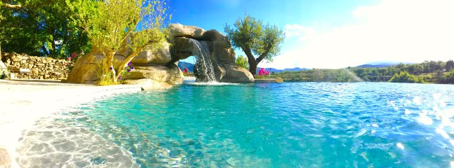 Pool and cave with view.