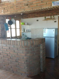 Fully quipped kitchen with large stove 6 hotplates and two door fridge.