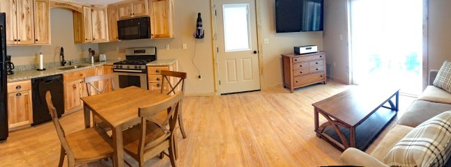 Panoramic view of the living area and kitchen in the Mountain View Cottage!