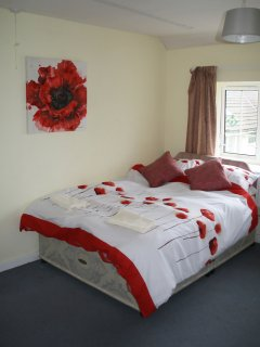 Bedroom with double bed & bunks