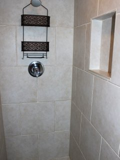 It has a large, tiled shower for your use.