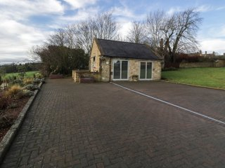 THE LODGE, stone-built, detached, open plan studio accommodation, romantic retre