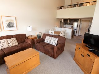 Spacious 1 Bedroom Suite with Loft, Balcony, Full Kitchen, + Fireplace