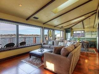 Bayfront condo with gorgeous views, decks, a shared hot tub, and firepit!
