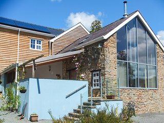 THE BARN AT GLANOER, stone-built barn conversion, roll-top bath, woodburner, an