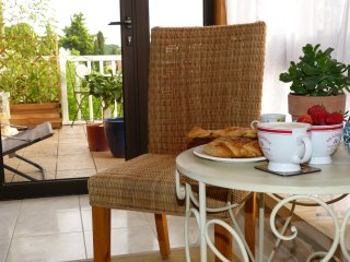 There is a conservatory leading out to the balcony.  A great place for a cup of coffee & a croissant