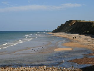 Nearby West Runton beach, perfect for sand castles, relaxing, walking, and fossil hunting.