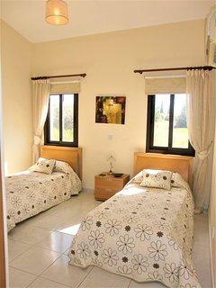 Twin bedroom with en-suite bathroom, views over the green area