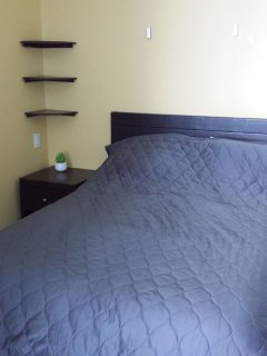 matrimonial bed (between a queen and a double) in bedroom