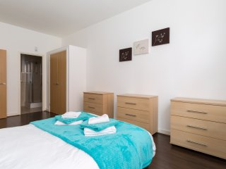 main bedroom with large double wardrobe, 3 large drawers & 2 bedside cabinets with lamps